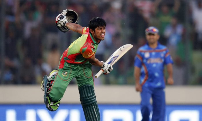 Bangladesh's batsman Anamul Haque celebrates after hitting the winning shot during their ICC Twenty20 Cricket World Cup opening match against Afghanistan in Dhaka, Bangladesh, Sunday, March 16, 2014. Bangladesh won the match by nine wickets. (AP Photo/Aijaz Rahi)