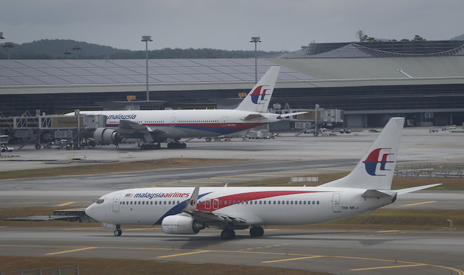 A Malaysia Airline Boeing 737-800 plane taxis by main terminal at Kuala Lumpur International Airport in Sepang, Sunday, March 16, 2014. Malaysia. A Malaysian passenger jet missing for more than a week had its communications deliberately disabled and its last signal came about seven and a half hours after takeoff, meaning it could have ended up as far as Kazakhstan or deep in the southern Indian Ocean, Malaysia's Prime Minister Najib Razak said Saturday. (AP Photo/Vincent Thian)
