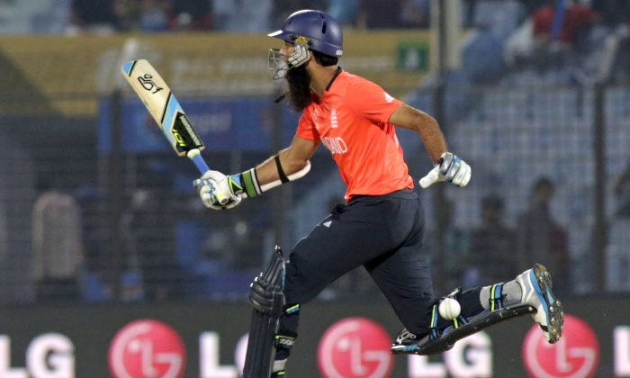 England's Moeen Ali takes a run during an ICC Twenty20 Cricket World Cup match against New Zealand in Chittagong, Bangladesh, Saturday, March 22, 2014. (AP Photo/Bikas Das)