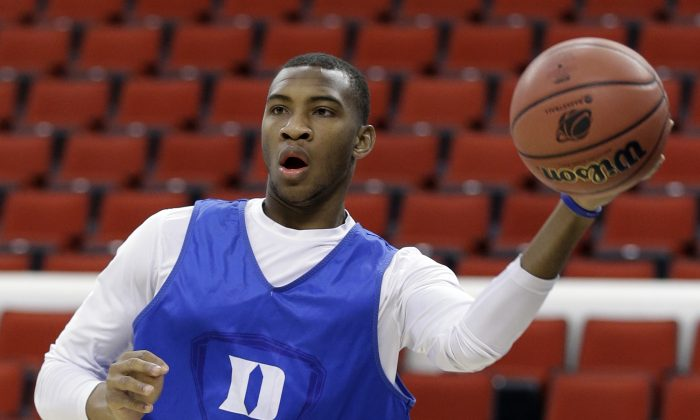 Duke's Rasheed Sulaimon passes the ball during practice at the NCAA college basketball tournament in Raleigh, N.C., Thursday, March 20, 2014. Duke plays Mercer in a second-round game on Friday. (AP Photo/Gerry Broome)