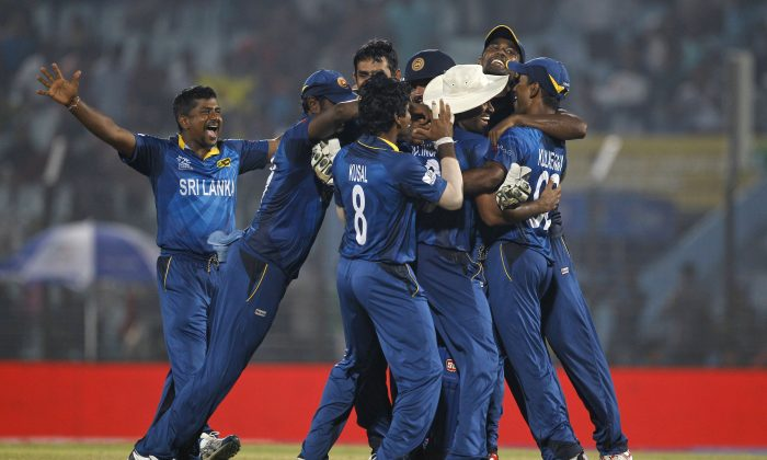 Sri Lanka players celebrate their victory against New Zealand during their ICC Twenty20 Cricket World Cup match in Chittagong, Bangladesh, Monday, March 31, 2014. Sri Lanka won by 59 runs. (AP Photo/A.M. Ahad)