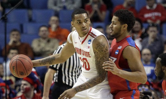 Ohio State's LaQuinton Ross (10) works the the ball against Dayton's Devin Oliver (5) during the first half of a second-round game in the men's NCAA college basketball tournament Thursday, March 20, 2014, in Buffalo, N.Y.  (AP Photo/Bill Wippert)
