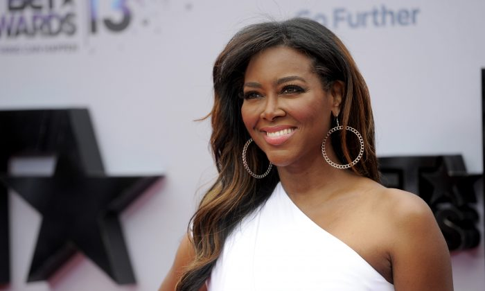 Kenya Moore arrives at the BET Awards at the Nokia Theatre on Sunday, June 30, 2013, in Los Angeles. (Photo by Chris Pizzello/Invision/AP)