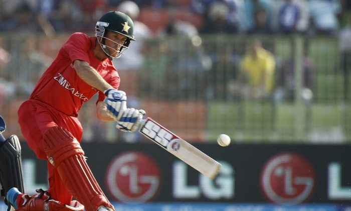 Zimbabwe's cricket player Sean Williams plays a shot during the ICC Twenty20 Cricket World Cup match against Ireland in Sylhet, Bangladesh, Monday, March 17, 2014. (AP Photo/A.M. Ahad)