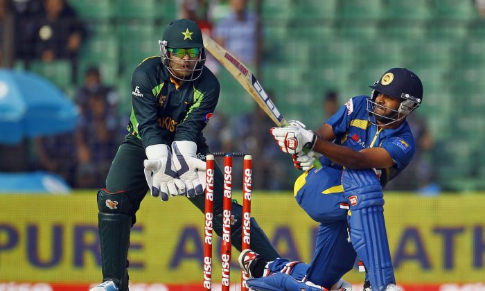 Sri Lanka's Lahiru Thirimanne, right, plays a shot as Pakistan's wicketkeeper Umar Akmal watches during the opening match in the 2014 Asia Cup. Sri Lanka won that match by 12 runs, but the teams meet again on March 8 in the tournament final. (AP Photo/A.M. Ahad)