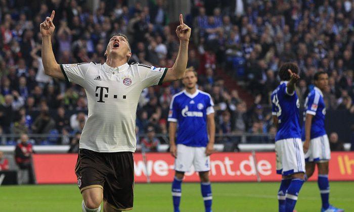 Bayern's Bastian Schweinsteiger celebrates after scoring during the German first division Bundesliga soccer match between Schalke 04 and Bayern Munich in Gelsenkirchen, Germany, Saturday, Sept. 21, 2013. (AP Photo/Frank Augstein)