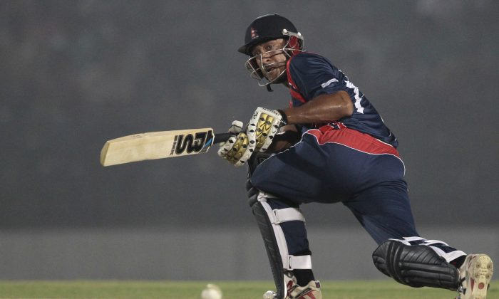 Nepal''s Paras Khadka plays a shot during a warm-up cricket match against Ireland ahead of the Twenty20 World Cup Cricket in Fatullah, near Dhaka, Bangladesh, Wednesday, March 12, 2014. (AP Photo/A.M. Ahad)