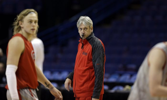 New Mexico head coach Craig Neal watches his team during practice for the NCAA college basketball tournament Thursday, March 20, 2014, in St. Louis. New Mexico is scheduled to play Stanford in a second-round game on Friday. (AP Photo/Jeff Roberson)
