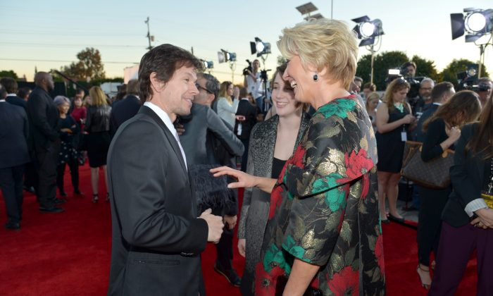 From left, Mark Wahlberg, Gaia Romilly Wise, and Emma Thompson arrive at the 19th annual Critics' Choice Movie Awards at the Barker Hangar on Thursday, Jan. 16, 2014, in Santa Monica, Calif. (John Shearer/Invision/AP)