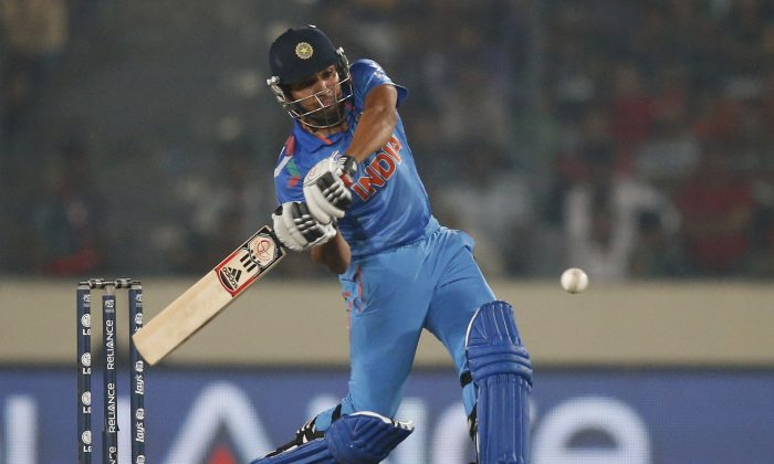 India's batsman Rohit Sharma plays a shot during their ICC Twenty20 Cricket World Cup match against Bangladesh in Dhaka, Bangladesh, Friday, March 28, 2014. India won by eight wickets. (AP Photo/Aijaz Rahi)