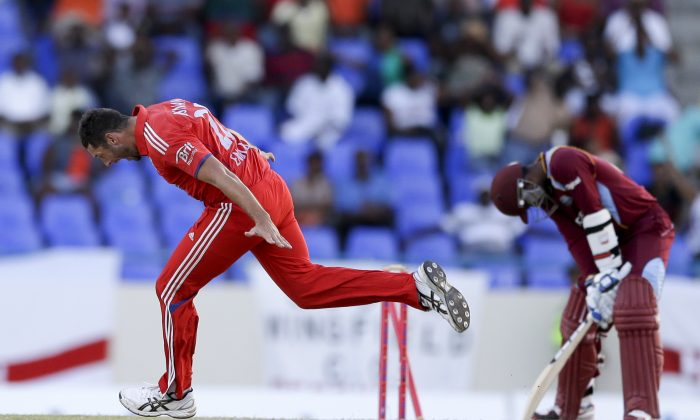 England's Tim Bresnan celebrates taking the last of West Indies wickets to win the match during their third one-day international cricket match at the Sir Vivian Richards Cricket Ground in St. John's, Antigua, Wednesday, March 5, 2014. (AP Photo/Ricardo Mazalan)