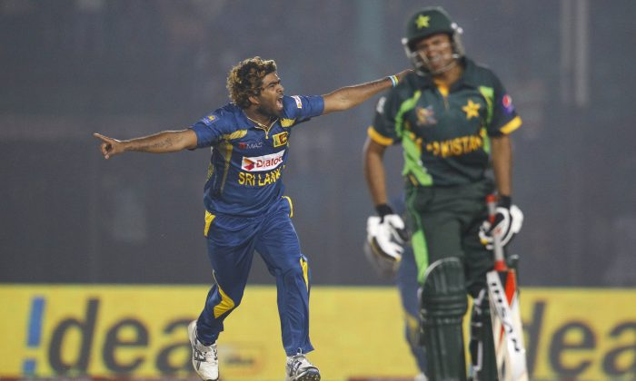Sri Lanka's Lasith Malinga, left, celebrates taking the wicket of Pakistan's Bilawal Bhatti during the opening match of the Asia Cup one-day international cricket tournament between them in Fatullah, near Dhaka, Bangladesh, Tuesday, Feb. 25, 2014. Sri Lanka won by 12 runs. (AP Photo/A.M. Ahad)