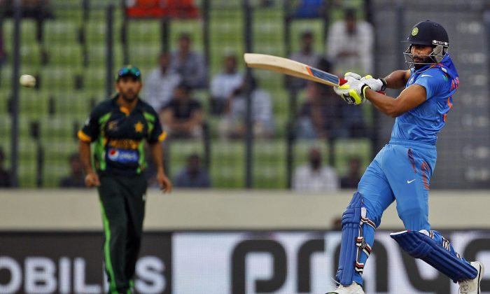 India's Ravindra Jadeja plays a shot during the Asia Cup one-day international cricket tournament against Pakistan in Dhaka, Bangladesh, Sunday, March 2, 2014. (AP Photo/A.M. Ahad)