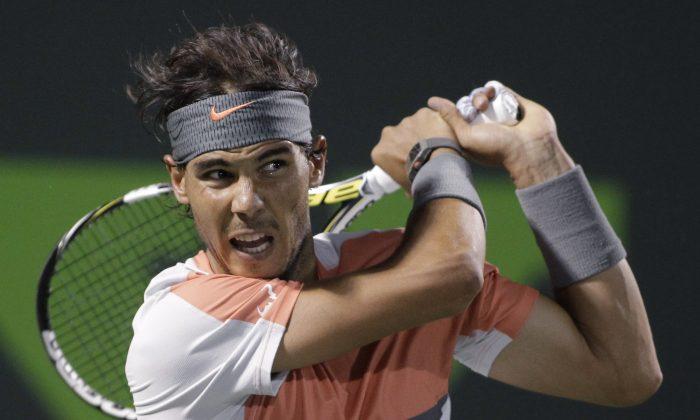 Rafael Nadal, of Spain, follows through on a return to Fabio Fognini, of Italy, during the Sony Open tennis tournament, Tuesday, March 25, 2014, in Key Biscayne, Fla. Nadal won 6-2, 6-2. (AP Photo/Luis M. Alvarez)