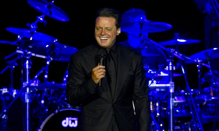 This March 11, 2012 file photo, shows Mexican singer Luis Miguel performing at a concert in Rio de Janeiro, Brazil. (AP Photo/Felipe Dana, File)
