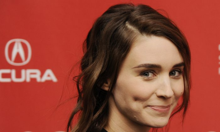 "Actress Rooney Mara smiles as she arrives at the premiere of the film ""The One I Love"" at the 2014 Sundance Film Festival, Tuesday, Jan. 21, 2014, in Park City, Utah. (Chris Pizzello/Invision/AP)"