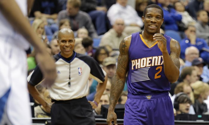 Phoenix Suns guard Eric Bledsoe (2) laughs after talking with referee Sean Corbin, left, during the third quarter of an NBA basketball game against the Minnesota Timberwolves in Minneapolis, Sunday, March 23, 2014. The Suns won 127-120. (AP Photo/Ann Heisenfelt)