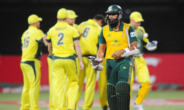 In this photo taken Wednesday, March 12, 2014, South Africa's Hashim Amla leaves the field after being dismissed for four runs during their rain-delayed T20 cricket match against Australia in Durban, South Africa. (AP Photo)