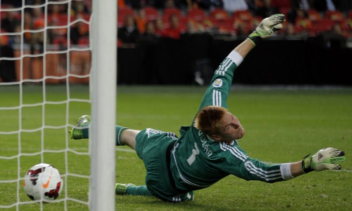 Hungary's goalkeeper Adam Bogdan fails to stop a shot on goal by Netherlands' Jeremain Lens who scored 3-0 during the Group D World Cup qualifying soccer match between Netherlands and Hungary, at ArenA stadium in Amsterdam, Netherlands, Friday Oct. 11, 2013. (AP Photo/Peter Dejong)
