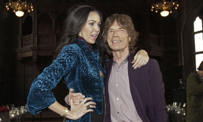 This Feb. 16, 2012 file photo shows singer Mick Jagger, right, with designer L'Wren Scott after her Fall 2012 collection was modeled during Fashion Week, in New York. Scott was found dead Monday, March 17, 2014, in Manhattan of a possible suicide. (AP Photo/Richard Drew, File)