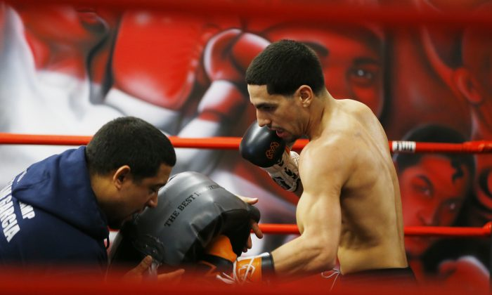 Danny Garcia spars during a media workout, Wednesday, Feb. 26, 2014, in Philadelphia. Garcia is scheduled to face Mauricio Herrera on March 15 at Coliseo Ruben Rodriguez in Bayamon, Puerto Rico. (AP Photo/Matt Rourke)