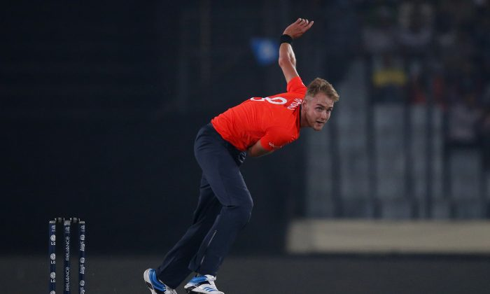 England captain Stuart Broad bowls during their ICC Twenty20 Cricket World Cup warm up match against India in Dhaka, Bangladesh, Wednesday, March 19, 2014. (AP Photo/Aijaz Rahi)