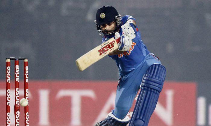 India's Virat Kohli plays a shot during the Asia Cup one-day international cricket tournament against Bangladesh in Fatullah, near Dhaka, Bangladesh, Wednesday, Feb. 26, 2014. (AP Photo/A.M. Ahad)