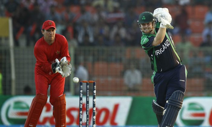 Ireland batsman Paul Stirling, right, plays a shot, as Zimbabwe wicketkeeper Brendan Taylor watches during their ICC Twenty20 Cricket World Cup match in Sylhet, Bangladesh, Monday, March 17, 2014. (AP Photo/A.M. Ahad)