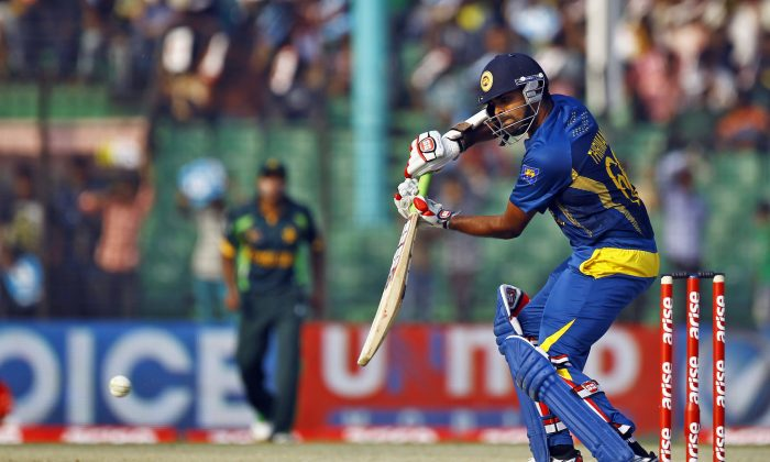 Sri Lanka's Lahiru Thirimanne plays a shot during the opening match of the Asia Cup one-day international cricket tournament against Pakistan in Fatullah, near Dhaka, Bangladesh, Tuesday, Feb. 25, 2014. (AP Photo/A.M. Ahad)