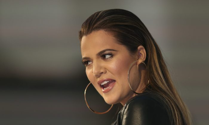 Khloe Kardashian greets fans at a shopping centre appearance in Sydney, Australia, Thursday, Nov. 21, 2013. (AP Photo/Rob Griffith)