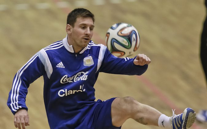 Argentina's Lionel Messi controls a ball up during a team training session in Bucharest, Romania, Monday, March 3, 2014. Argentina will play a friendly soccer match against Romania on Wednesday Mar. 5. (AP Photo/Vadim Ghirda)