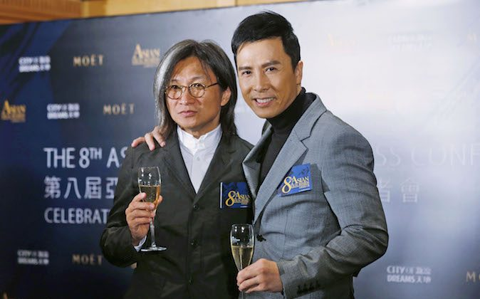 Jury President, Hong Kong director Peter Chan, left, and Celebrity Jury, martial art movie star Donnie Yen pose during the news conference of the Asian Film Awards (AFA) in Hong Kong Tuesday, Feb. 11, 2014. An annual Asian Film Awards will be held in Macau on March 27. (AP Photo/Kin Cheung)