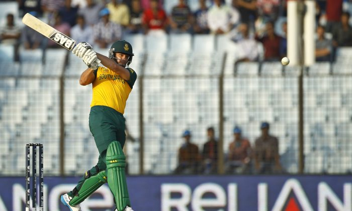 South Africa's Albie Morkel plays a shot during their ICC Twenty20 Cricket World Cup match against New Zealand in Chittagong, Bangladesh, Monday, March 24, 2014. (AP Photo/A.M. Ahad)