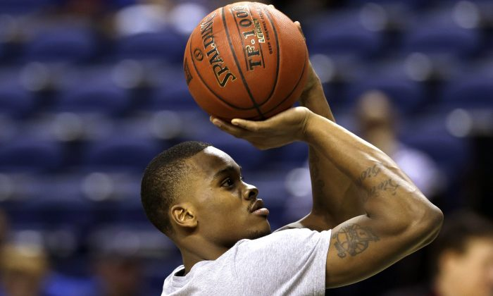 Florida State's Aaron Thomas shoots during an NCAA college basketball practice for the Atlantic Coast Conference tournament, Tuesday, March 11, 2014, in Greensboro, N.C. Florida State is scheduled to play Maryland in a second round game on Thursday. (AP Photo/Gerry Broome)