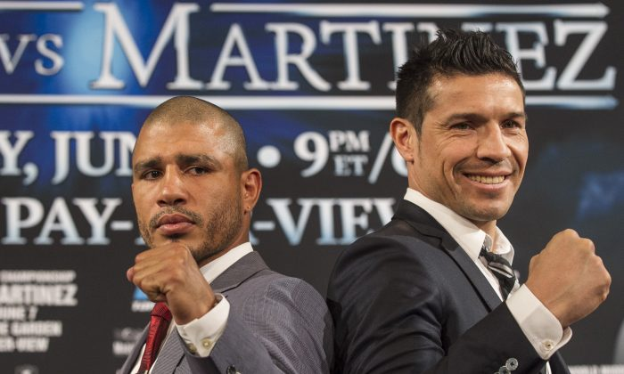WBC middleweight champion Sergio Martinez, right, of Argentina, and challenger Miguel Cotto, of Puerto Rico, pose for photos during a news conference in Beverly Hills, Calif., Wednesday, Mar. 12, 2014. Cotto and Martinez will face in a World Middleweight Championship bout scheduled June 7, in New York's Madison Square Garden. (AP Photo/Damian Dovarganes)