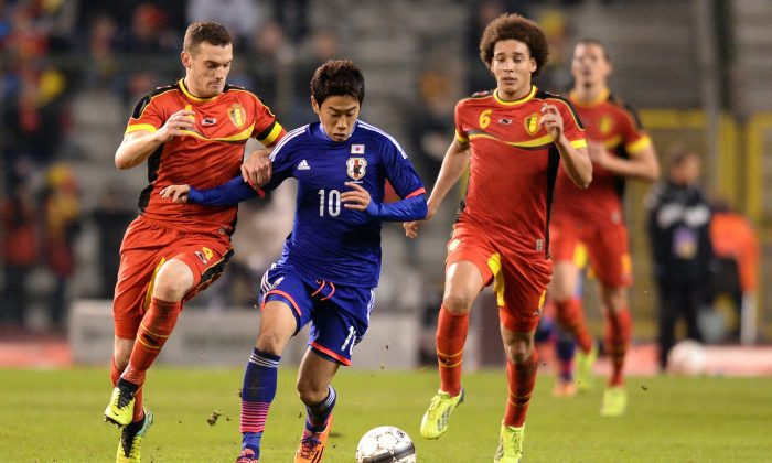 Belgium's Thomas Vermaelen, left, and Axel Witsel, right, challenge Japan's Shinji Kagawa during a friendly soccer match at the King Baudouin stadium in Brussels in this file photo. (AP Photo/Geert Vanden Wijngaert, File
