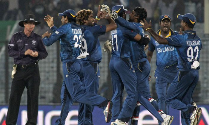 Sri Lanka cricketers celebrate their win over South Africa by 5 runs at the end of their ICC Twenty20 Cricket World Cup match in Chittagong, Bangladesh, Saturday, March 22, 2014. (AP Photo/Bikas Das)