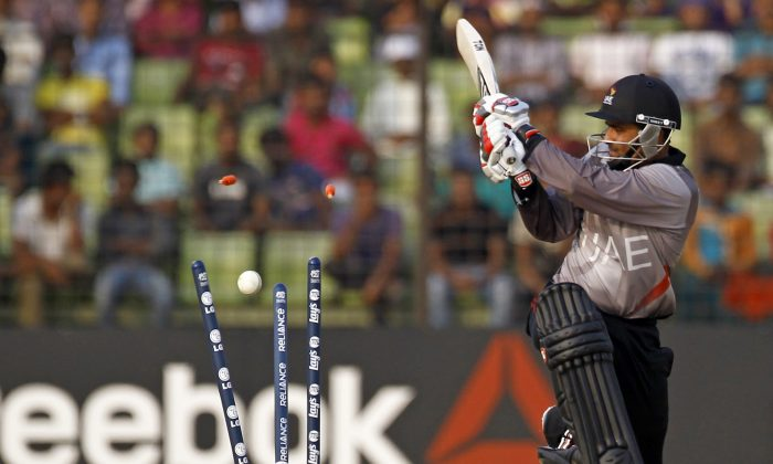 United Arab Emirates' Khurram Khan during a warm-up cricket match against Bangladesh ahead of the Twenty20 World Cup Cricket in Fatullah, near Dhaka, Bangladesh, Wednesday, March 12, 2014. (AP Photo/A.M. Ahad)