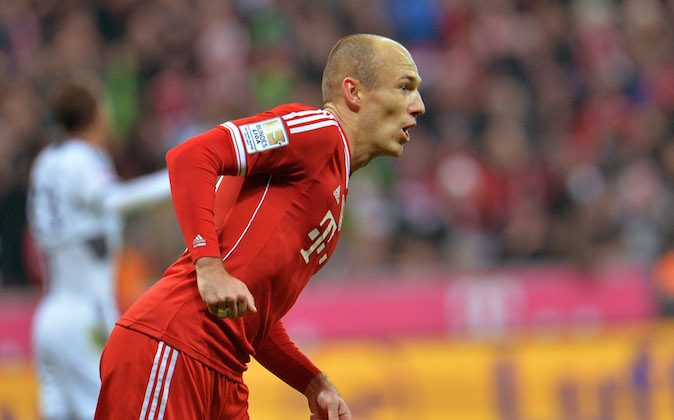 Bayern's  Arjen Robben of the Netherlands celebrates after scoring, during the German first division Bundesliga soccer match between  FC Bayern Munich and FC Schalke in Munich, Germany, on Saturday, Mar. 1. 2014. (AP Photo/Kerstin Joensson)