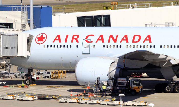 Air Canada aims to reduce costs by expanding its low-cost Rouge service to Vancouver and Calgary. (AP Photo/Rick Rycroft)