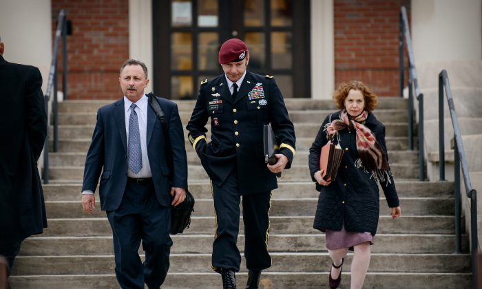 Brig. Gen. Jeffrey Sinclair leaves the courthouse with his lawyers Richard Scheff (L), and Ellen C. Brotman, at Fort Bragg, N.C., on March 4. (The Fayetteville Observer, James Robinson/AP)