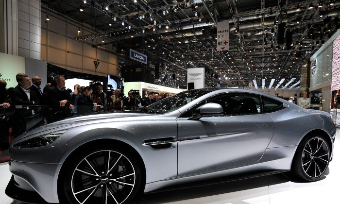 Visitors view the Aston Martin Vanquish during the 83rd Geneva Motor Show last March. The Vanquish will also be on display at the Ottawa Gatineau International Auto Show on March 20—23, 2014, at the Ottawa Convention Centre. (Harold Cunningham/Getty Images)