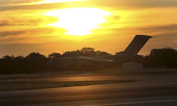 Royal Australia Air Force C-17 lands at RAAF Base Pearce to deliver a Sea Hawk helicopter to help with the search for the missing Malaysia Airlines Flight MH370, in Perth, Australia, Friday, March 28, 2014. (AP Photo/Rob Griffith)