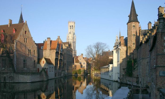 """One of the most well-maintained medieval cities of Europe, Belgium's """"Venice of the North"""" is a peaceful fantasy world. Best known as the setting for the cult film """"In Bruges"""" starring Colin Farrell and Brendan Gleeson, the old city will be underwater with about 1.8 degrees of warming."""