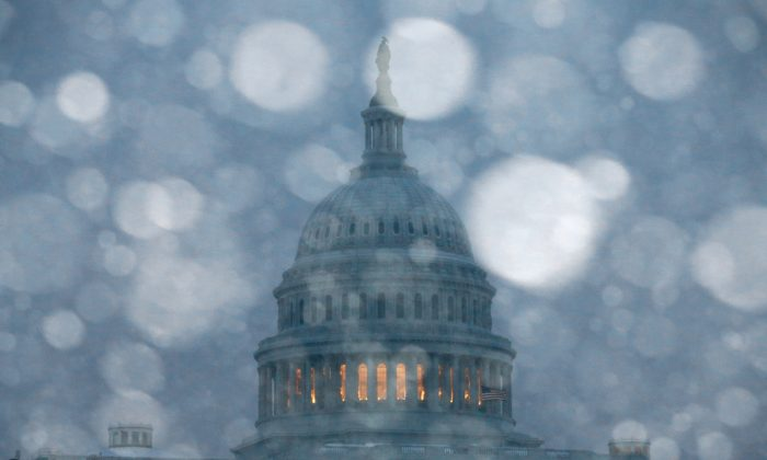 Snow falls in front of the U.S. Capitol in Washington, D.C., March 3, 2014. (Mark Wilson/Getty Images)