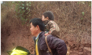 Chinese Father Carries Disabled Son Nine Miles a Day for School