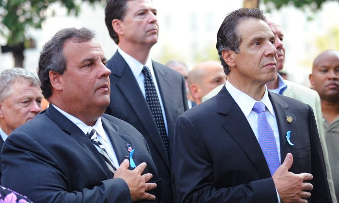 New Jersey Gov. Chris Christie (L) and New York Gov. Andrew Cuomo (R) hold their hands over their hearts at the 9/11 Memorial during ceremonies at the World Trade Center site in New York on Sept. 11, 2013. (David Handschuh /Getty Images)