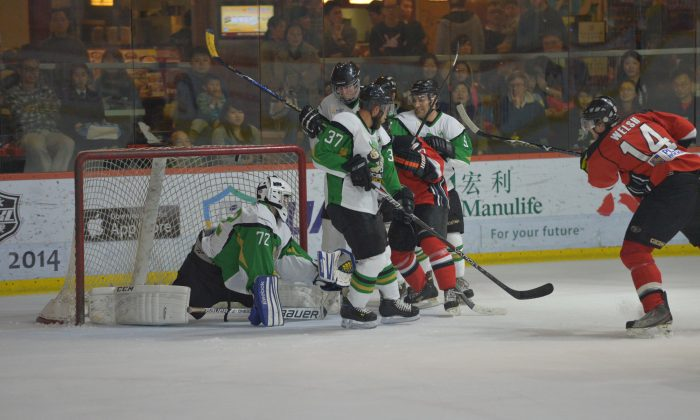 Devin Welsh of the Kowloon Warriors fired into the top of the net to take a 3-2 lead in the third minute of Period-2. Warriors defeated Macaus Aces 7-2 in the first round of best-of-three playoffs in the CIHL on Saturday Mar 1, 2014. (Patrick Calkins)