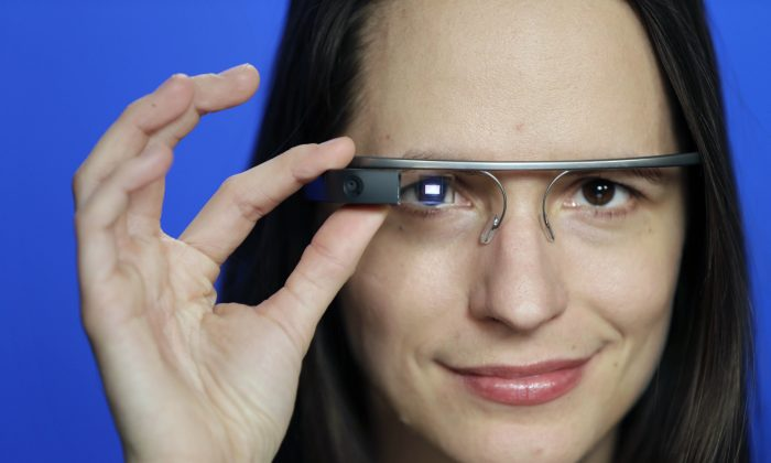 Associated Press Technology Writer Barbara Ortutay poses wearing Google Glass in New York. (AP Photo/Seth Wenig, File)
