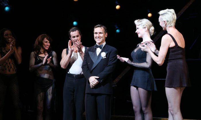 "Elvis Stojko (C) at curtain call during his debut performance of the Broadway musical ""Chicago"" at New York City's Ambassador Theatre on March 17, 2014. The show is running at Toronto's Princess of Wales Theatre, March 26-30. (Rob Kim/Getty Images)"